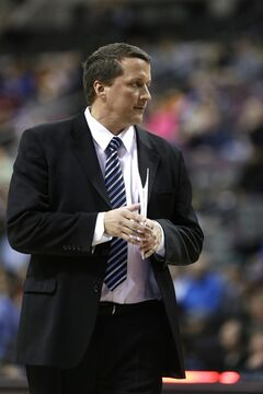 Detroit Pistons interim head coach John Loyer stands on the sideline the first half of an NBA basketball game against the San Antonio Spurs in Auburn Hills, Mich., Monday, Feb. 10, 2014. (AP Photo/Carlos Osorio)