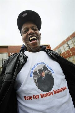 Tony Robertson shows his support for Detroit mayoral candidate Benny Napoleon, as well as his admiration for former Detroit Mayor Coleman Young, outside the polling place at the Greater Emmanuel Church, Tuesday, Nov. 5, 2013, in Detroit. (AP Photo/Detroit News, Daniel Mears) DETROIT FREE PRESS OUT; HUFFINGTON POST OUT