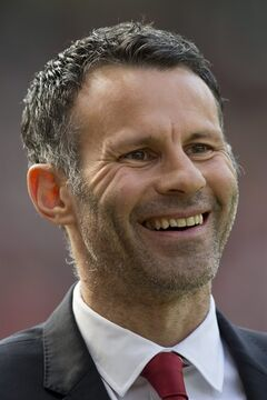 Manchester United's interim manager Ryan Giggs smiles as he takes to the touchline before his team's English Premier League soccer match against Sunderland at Old Trafford Stadium, Manchester, England, Saturday May 3, 2014. (AP Photo/Jon Super)