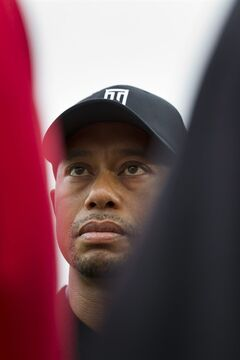 Tiger Woods of the US answers questions from reporters after a practice round at Royal Liverpool Golf Club prior to the start of the British Open Golf Championship, in Hoylake, England, Saturday, July 12, 2014. The 2014 Open Championship starts on Thursday July 17. (AP Photo/Jon Super)