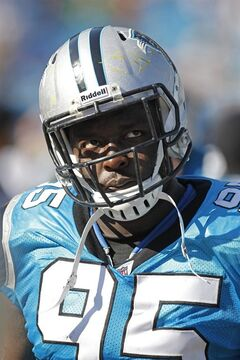 FILE - In this Oct, 23, 2011 file photo, Carolina Panthers' Charles Johnson (95) looks on from the sidelines against the Washington Redskins during an NFL football game in Charlotte, N.C. The man teammates call