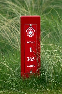FILE - This April 23, 2014, file photo, shows a yardage marker showing the distance on the first hole at Royal Liverpool Golf Club in Hoylake, England. The British Open golf championship begins on Thursday July 17, 2014. (AP Photo/Jon Super, File)