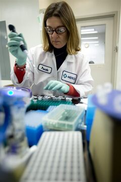 In this Thursday, Feb. 28, 2013 photo, Merck scientist Pascale Nantermet conducts research to discover new HIV drugs in West Point, Pa. Merck reports quarterly financial results on Tuesday, July 29, 2014. (AP Photo/Matt Rourke)