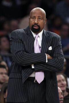 New York Knicks head coach Mike Woodson watches his players from the bench during the first half of their NBA basketball game against the Oklahoma City Thunder at Madison Square Garden, Wednesday, Dec. 25, 2013, in New York. (AP Photo/John Minchillo)