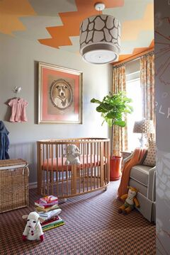 An autumnal nursery designed by Brian Patrick Flynn with ceramic animal hooks for infant clothing in the Brooklyn borough of New York. The hooks add storage space and decorative flair, while making sure favorite outfits get used before the baby grows out of them. (AP Photo/Brian Patrick Flynn, Hgtv.com, Sarah Dorio)