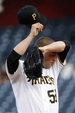 Pittsburgh Pirates starting pitcher Brandon Cumpton (58) wipes his head during the first inning of a baseball game against the Cincinnati Reds in Pittsburgh Tuesday, June 17, 2014. (AP Photo/Gene J. Puskar)