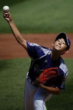 South Korea's Jae Yeong Hwang pitches during the first inning of an international pool play baseball game against Czech Republic at the Little League World Series, Thursday, Aug. 14, 2014, in South Williamsport. South Korea won 10-3. (AP Photo/Matt Slocum)