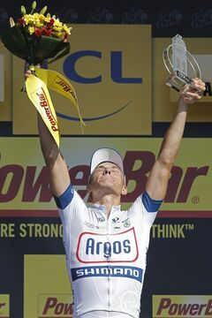 Stage winner Marcel Kittel of Germany celebrates on the podium of the tenth stage of the Tour de France cycling race over 197 kilometers (123.1 miles) with start in in Saint-Gildas-des-Bois and finish in Saint-Malo, Brittany region, western France, Tuesday July 9 2013. (AP Photo/Laurent Cipriani)