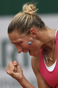 Belgium's Yanina Wickmayer celebrates scoring a point during the first round match of the French Open tennis tournament against Denmark's Caroline Wozniacki at the Roland Garros stadium, in Paris, France, Tuesday, May 27, 2014. (AP Photo/Darko Vojinovic)