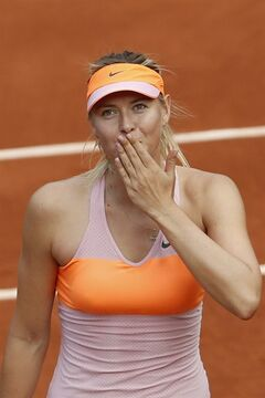 Russia's Maria Sharapova blows a kiss to spectators after winning her third round match of the French Open tennis tournament against Argentina's Paula Ormaechea at the Roland Garros stadium, in Paris, France, Friday, May 30, 2014. Sharapova won in two sets 6-0, 6-0. (AP Photo/Darko Vojinovic)