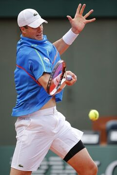 John Isner of the U.S. returns the ball during the third round match of the French Open tennis tournament against Spain's Tommy Robredo at the Roland Garros stadium, in Paris, France, Friday, May 30, 2014. Isner won in four sets 7-6, 7-6, 6-7, 7-5. (AP Photo/David Vincent)