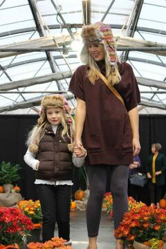 Two models make their way down the catwalk during the recent Shelmerdine Garden Centre fashion show wearing warm wool hats designed to ward off winter's winds.