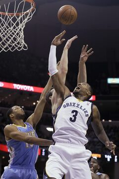 Denver Nuggets' Anthony Randolph, left, and Memphis Grizzlies' James Johnson (3) and Jon Leuer, center, go up for a rebound during the first half of an NBA basketball game in Memphis, Tenn., Saturday, Dec. 28, 2013. (AP Photo/Danny Johnston)