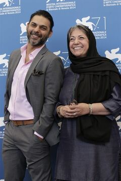 Peyman Moaadi and Rakhshan Bani-E'temad pose for photographers at the photo call for the movie Ghesseha during the 71st edition of the Venice Film Festival in Venice, Italy, Thursday, Aug. 28, 2014. (AP Photo/David Azia)