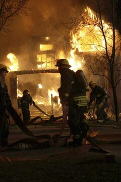 Firefighters at the scene of Tuesday's early-morning fire on McMillan Avenue.