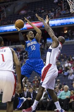 Orlando Magic forward Tobias Harris drives to the basket against Washington Wizards forward Chris Singleton during the first half of an NBA basketball game, Tuesday, Feb. 25, 2014, in Washington. (AP Photo/ Evan Vucci)