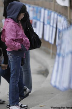 Celine Ponace, 11, checks out posters dedicated to some of the missing and murdered women.