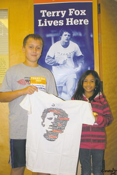 St. Joseph the Worker School students Sophia Abimanan and Eric Tokar took part in the Terry Fox National School Run Day last week with their schoolmates.