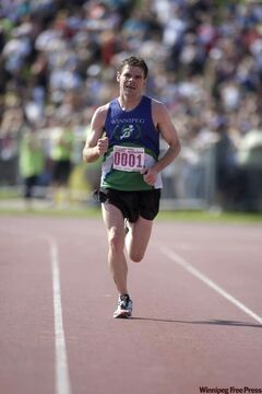 Michael Booth nears the finish line to win his fourth Manitoba Marathon.