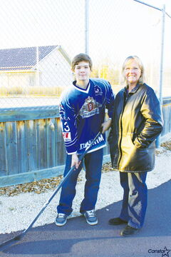 Garrett Henderson and mom Leslie enjoy hotels that cater to hockey teams.
