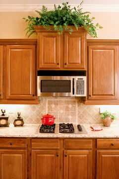 A bristle brush and a quality degreaser can work wonders on an Arborite countertop.