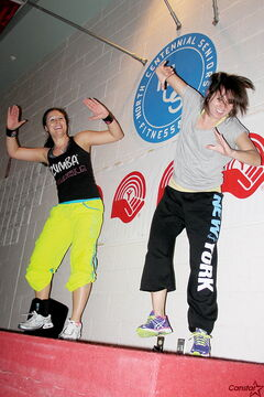 Zumba instructor Melissa Boychuk, left, cheers on fellow instructor Karla Muñoz Perez during a Zumbathon fundraiser for the United Way, which took place at the North Centennial Recreation and Leisure Facility Jan. 26.