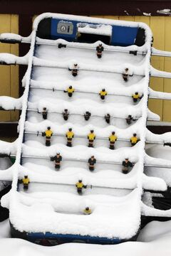 A foosball  table left outside on Burrows Avenue is covered in snow.