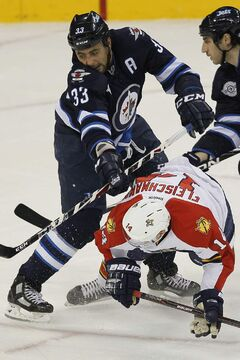 Winnipeg Jets defenceman Dustin Byfuglien (33) in a game against the Florida Panthers in Winnipeg. Byfuglien faces a number of boating charges in Minnesota, which will go to trial.