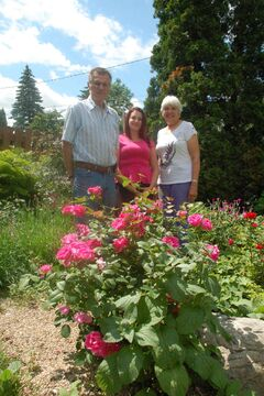Canadian Liver Foundation Manitoba chapter representatives Bianca Pengelly (centre) and Luella Stephens (right) are organizing a garden tour, which includes Stephens' husband's Jim's (left) gardens.