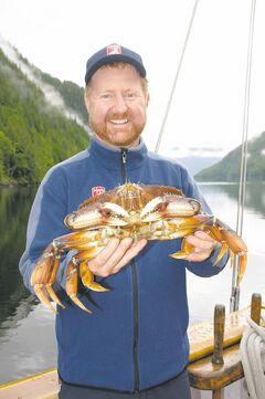 Maple Leaf skipper Kevin Smith displays part of the day's catch of Dungeness crab, which chef Steve Letts later prepares for a buttery feast on deck.