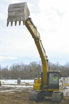 Sarah Rollason-MacAulay plays in the dirt with a full size excavator at Extreme Sandbox in the Twin Cities area.