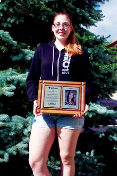 Kildonan-East Grade 12 student Christina Posthumus shows off her Credit Unions of Manitoba Scholar Athlete Award.