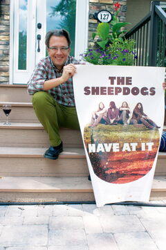 Director John Barnard shows off the poster for his rock documentary The Sheepdogs Have At It in front of his North Kildonan home.