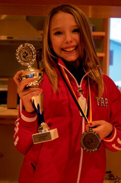 Tap dancer Athena Giesbrecht shows off her third-place trophy and medal from the International Dance Organization World Tap Dance Championships earlier this month.