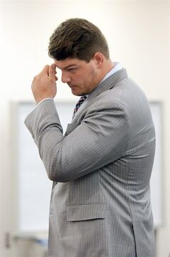 Tennessee Titans NFL football player Taylor Lewan looks on at the 15th District Court during a pre-trial hearing in Ann Arbor, Mich., on Thursday, July 17, 2014. The former Michigan offensive tackle is accused of punching an Ohio State fan after the Buckeyes beat the Wolverines last season. Lewan says he was breaking up a dispute and wasn't involved in a fight. (AP Photo/The Ann Arbor News, Melanie Maxwell) LOCAL TELEVISION OUT; LOCAL INTERNET OUT