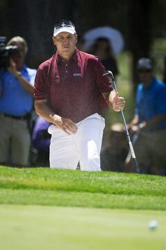 Former NFL quarterback Mark Rypien hits the ball out of the bunker during the American Century Championship golf tournament Sunday, July 20, 2014, at Edgewood Tahoe Golf Course in Stateline, Nev. (AP Photo/Reno Gazette-Journal, Hilary Swift)