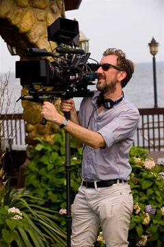 This image released by The Weinstein Company shows director John Carney on the set of