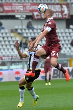 Torino defender Kamil Glik, right, and Udinese forward Luis Muriel vie for the ball during a Serie A soccer match between Torino and Udinese at the Olympic stadium, in Turin, Italy, Sunday, April 27, 2014. (AP Photo/ Massimo Pinca)