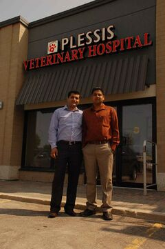 Dr. Sanjiv Bhandari and Dr. Sav Virdi are shown outside their Plessis Veterinary Hospital location. The clinic is set to open Aug. 8.