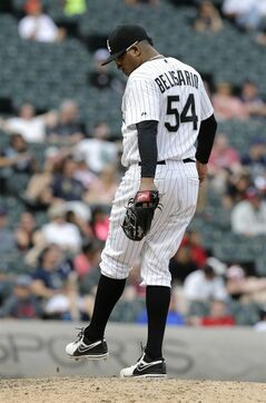Chicago White Sox relief pitcher Ronald Belisario kicks the dirt after Seattle Mariners' Michael Saunders hit a single during the 14th inning of a baseball game in Chicago on Saturday, July 5, 2014. (AP Photo/Nam Y. Huh)
