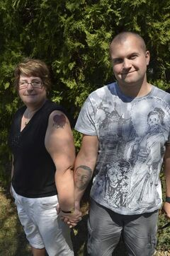 Mother Ethel Ljubic and brother Donovan Ljubic with tattoos of the late Jason Ljubic (left).