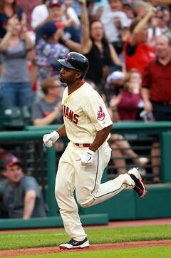 Cleveland Indians' Michael Bourn rounds heads for home plate after hitting a solo home run in the third inning of a baseball game against the Kansas City Royals Saturday July 5, 2014, in Cleveland. (AP Photo/Aaron Josefczyk)