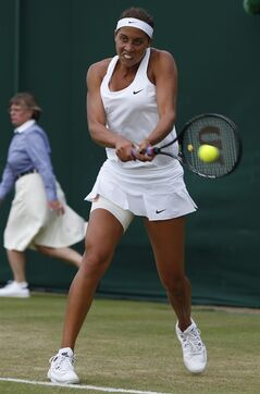 Madison Keys of U.S. plays a return to Klara Koukalova of Czech Republic during their women's singles match at the All England Lawn Tennis Championships in Wimbledon, London, Thursday, June 26, 2014. (AP Photo/Alastair Grant)