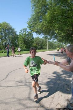 A young runner is given a popsicle on Lyndale Drive during today's Manitoba Marathon.