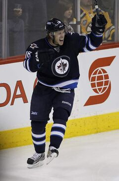 Winnipeg Jets' Bryan Little (18) had a two goal performance to help lift the Jets over the Boston Bruins during NHL hockey action in Winnipeg on Friday.