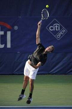 Jack Sock serves the ball against Michael Berrer, of Germany, during a match at the Citi Open tennis tournament, Tuesday, July 29, 2014, in Washington. (AP Photo/Nick Wass)