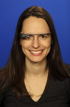 Associated Press Technology Writer Barbara Ortutay wears Google Glass in New York, Friday, Feb. 21, 2014. (AP Photo/Seth Wenig)