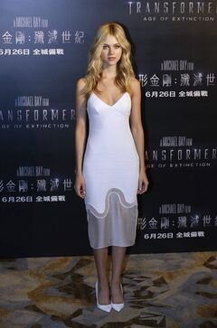 American actress Nicola Peltz poses before a news conference for the movie