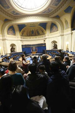Visitors at the Legislative Open House take a tour of the Legislative Chamber on Saturday.