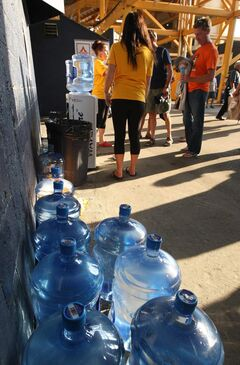 Fans fill up water bottles at Canad Inns Stadium Friday night.